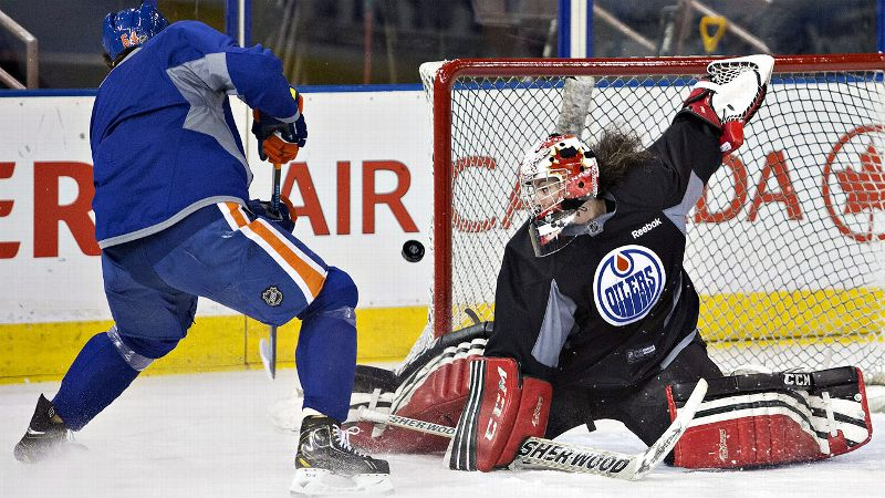 Team Canada women's team goalie Shannon Szabados makes a save on Nail Yakupov as she takes part in the Oilers' practice.