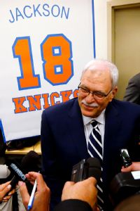 Sources: Phil signs on as Knicks president