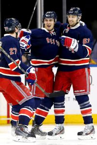 Kreider (center) celebrates with Ryan McDonagh and Rick Nash after lighting it up vs. Detroit.