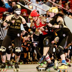 Suzy Hotrod, center, was an established roller derby star when Jonathan Rockey and other men were still on training wheels.