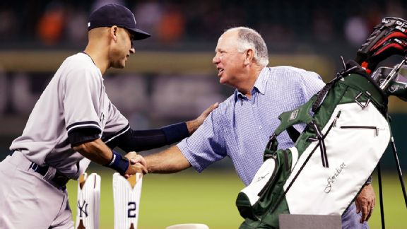 The New York Yankees' Derek Jeter with golfer Mark O'Meara