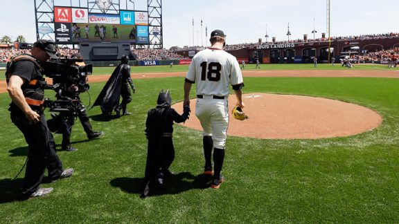 Miles Scott, aka Batkid, and Matt Cain before throwing out the first pitch at AT&T Park for the San Francisco Giants' home-opener.