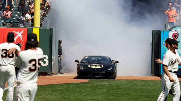 The Batmobile carrying Miles Scott, aka Batkid, before he threw out the first pitch at AT&T Park for the San Francisco Giants' home-opener.