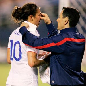 Carli Lloyd got both a bloody nose and a black eye from a header during a friendly game against China in San Diego.