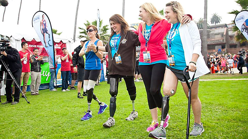 Boston bombing survivors Celeste Corcoran, Heather Abbott and Roseann Sdoia at a Challenged Athletes Foundation (CAF) run with Jami Goldman-Marseilles (far left), a CAF mentor.