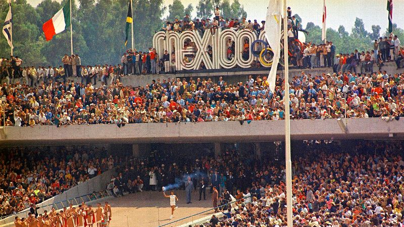 Mexico City welcomed the world for the 1968 Summer Olympics, marking the first time the Games were held in Latin America. The '68 Games are perhaps best remembered in the United States for Tommie Smith (gold) and John Carlos (bronze) and their iconic black-power salute from the 200-meter medal stand on the track. Mexico earned nine medals, including three golds -- two in men's boxing and one in men's swimming. It wasn't until 32 years later, at the 2000 Sydney Games, that a Mexican woman, weightlifter Soraya Jimenez, stood atop an Olympic podium. Jimenez died of a heart attack last year at the age of 35.
