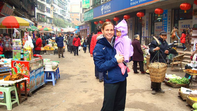 Christie Rampone with daughter Rylie -- an enthusiastic traveler -- at the Beijing Olympics.