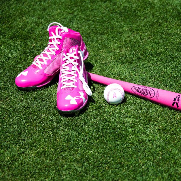 Pink cleats and bat