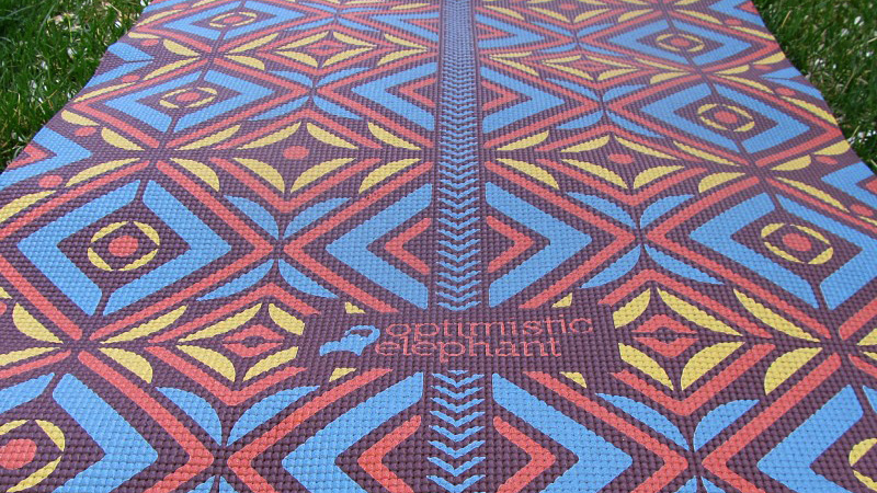 If you're in search of a distinctive accessory for your yoga practice, look no further. These mats offer a variety of designs and patterns printed with solvent-free inks. With a standard length of 71 inches, these quarter-inch-thick mats can be cut shorter and customized depending on your needs.