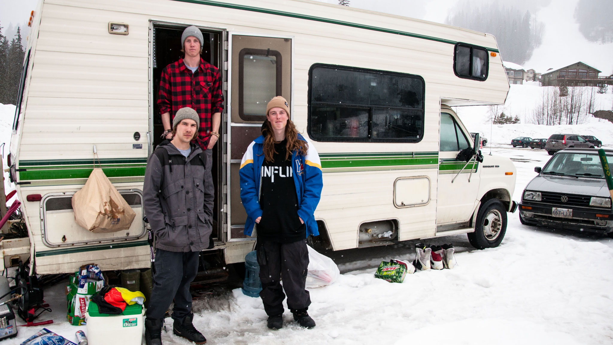 Inflik Media's Kaleb Weston, Kieran Nikula and Jarred Martin in front of their 1989 Ford motorhome.