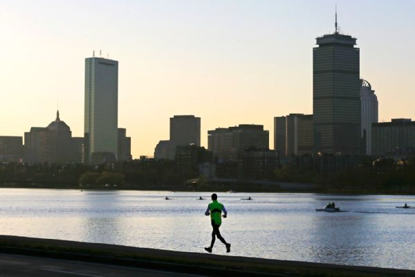Runner and Boston skyline