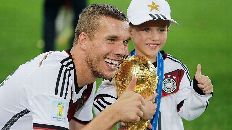 Lukas Podolski, here with his son, scored high marks for his selfies after Germany's World Cup win.