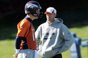 Payton Manning and Adam Gase