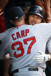 TORONTO, CANADA - JULY 21: Stephen Drew #23 of the Boston Red Sox is congratulated by Mike Carp #37 after hitting a three-run home run in the third inning during MLB game action against the Toronto Blue Jays on July 21, 2014 at Rogers Centre in Toronto, O
