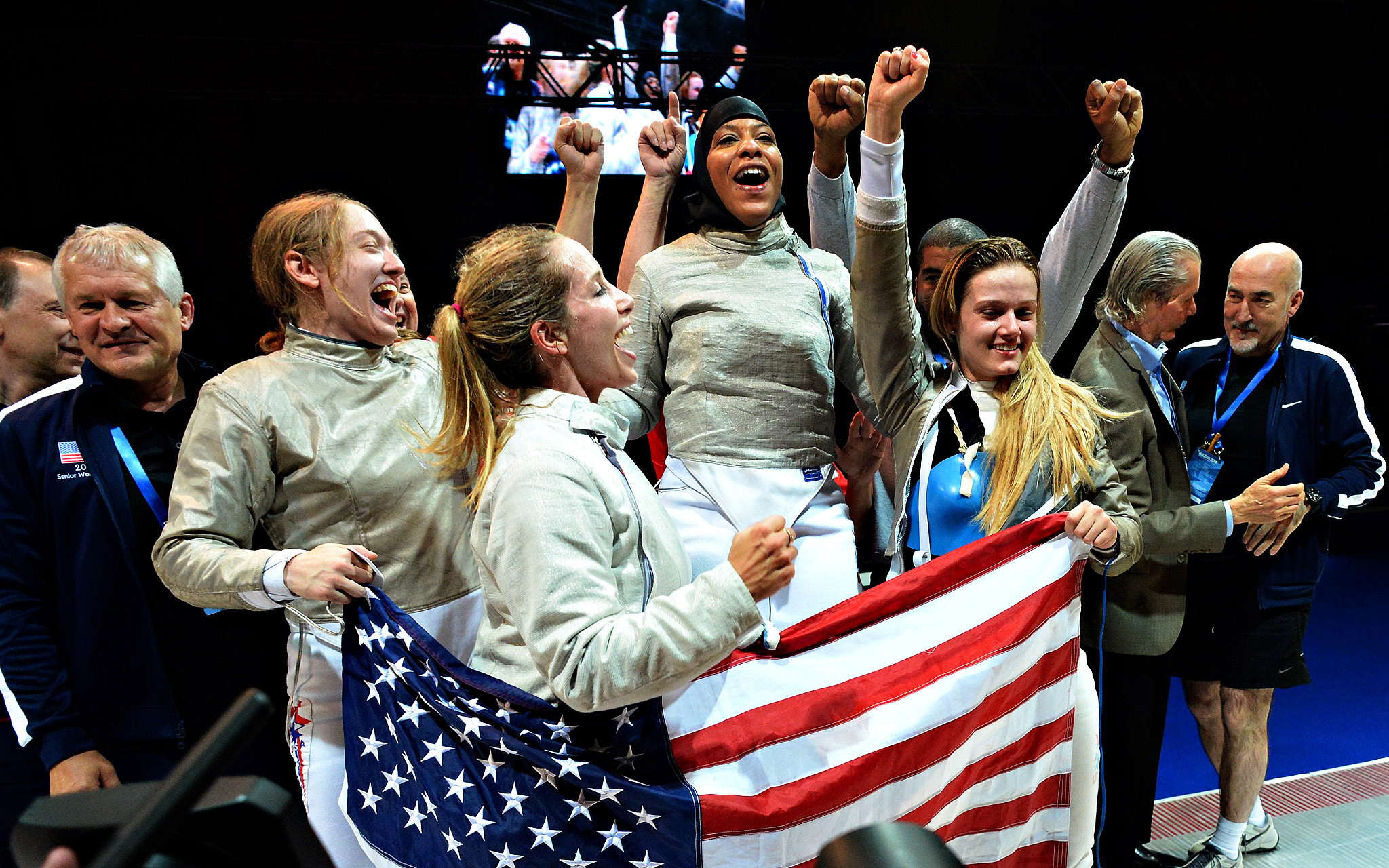 Members of the United States women's fencing team celebrate after winning the women's team sabre final at the 2014 world fencing championships in Kazan.