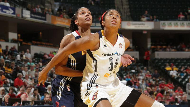 The Indiana Fever's Krystal Thomas, front, was just 16 when her mother died of breast cancer.
