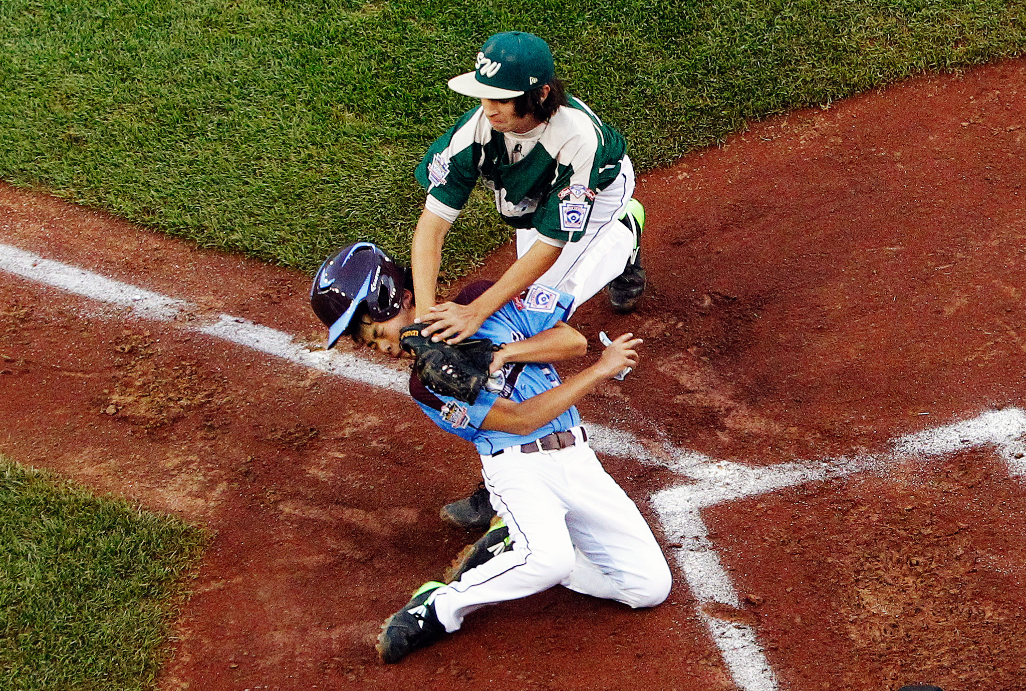 Philadelphia's Jack Rice was out at the plate when he was tagged by Pearland, Texas, pitcher Clayton Broeder at the Little League World Series.