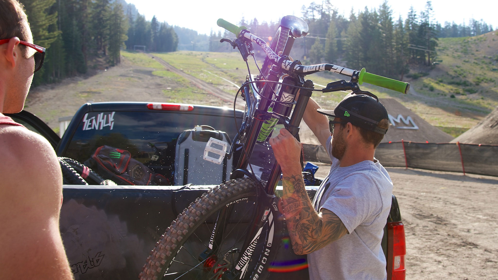 Zink loads up his bike Tuesday for another practice run at Mammoth while his brother Howie looks on.