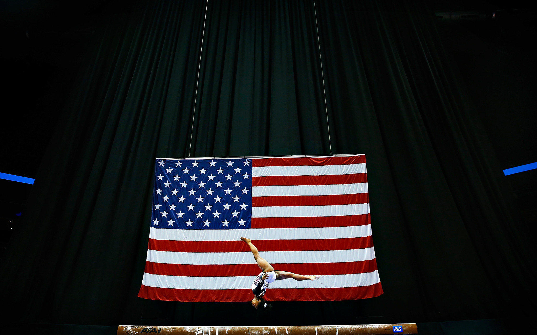 Simone Biles competes on the balance beam during the preliminaries at the U.S. women's gymnastics championships at Consol Energy Center in Pittsburgh. Biles sprinted to the lead as she closes in on a second straight national title.