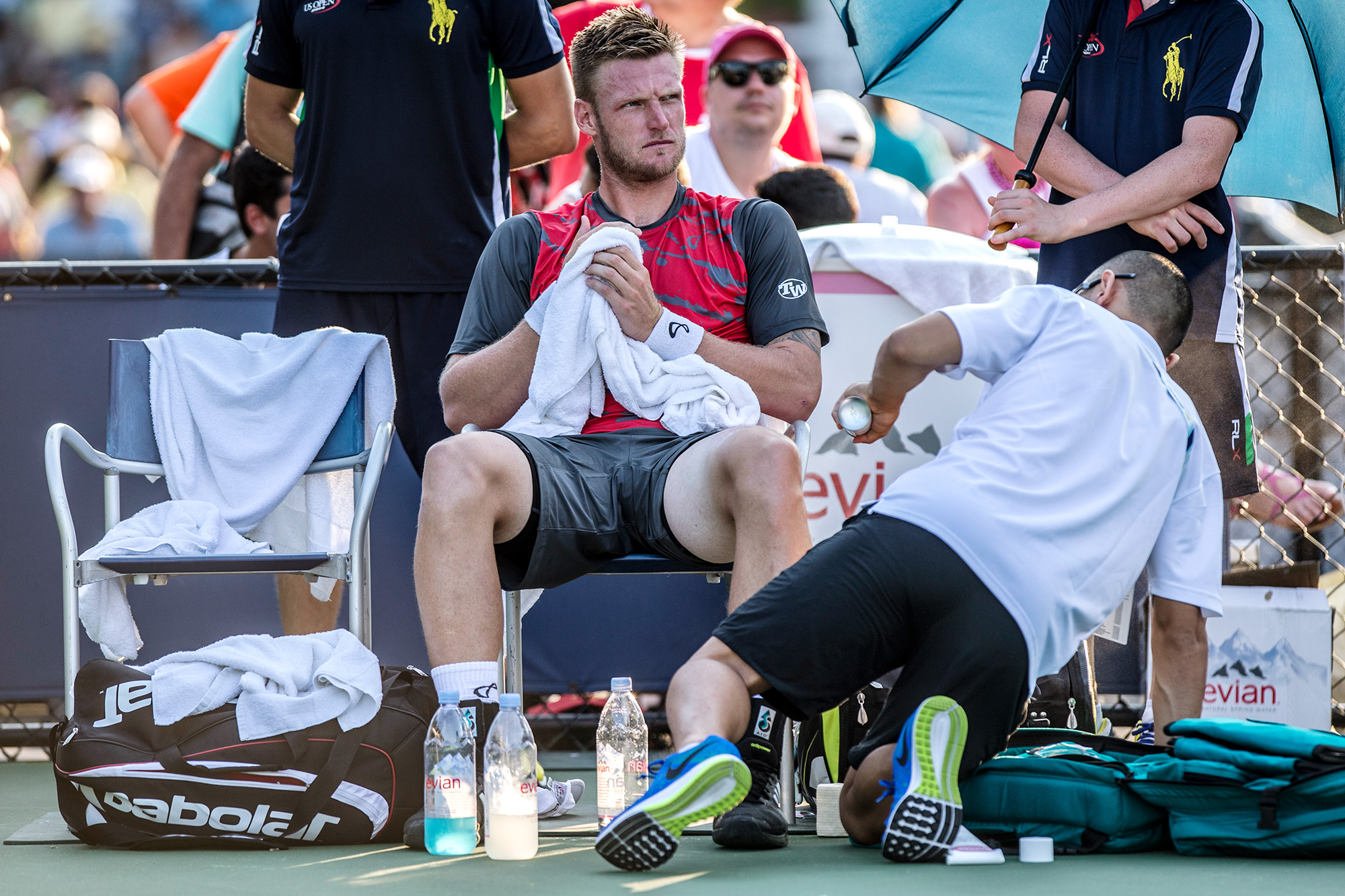 After taking a two-set lead behind his booming serve, Groth was sidelined with an apparent knee injury. Since there is no designated trainer on the court, he had to wait for one to be located elsewhere on the grounds before getting evaluated.