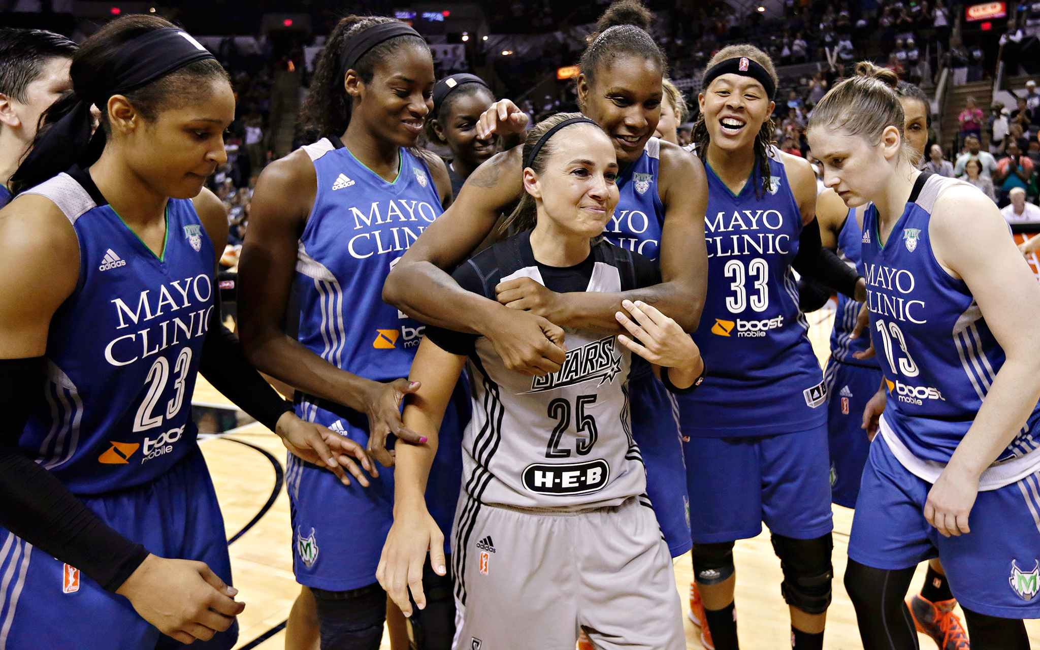 Minnesota Lynx players give Becky Hammon a fond farewell after eliminating  San Antonio in the Western Conference semifinals Saturday. Hammon is retiring after 16 seasons to become an assistant coach with the NBA's San Antonio Spurs.