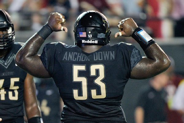 VANDY HAS PROBLEMS IN FIRST GAME, INCLUDING JERSEY FIASCO.