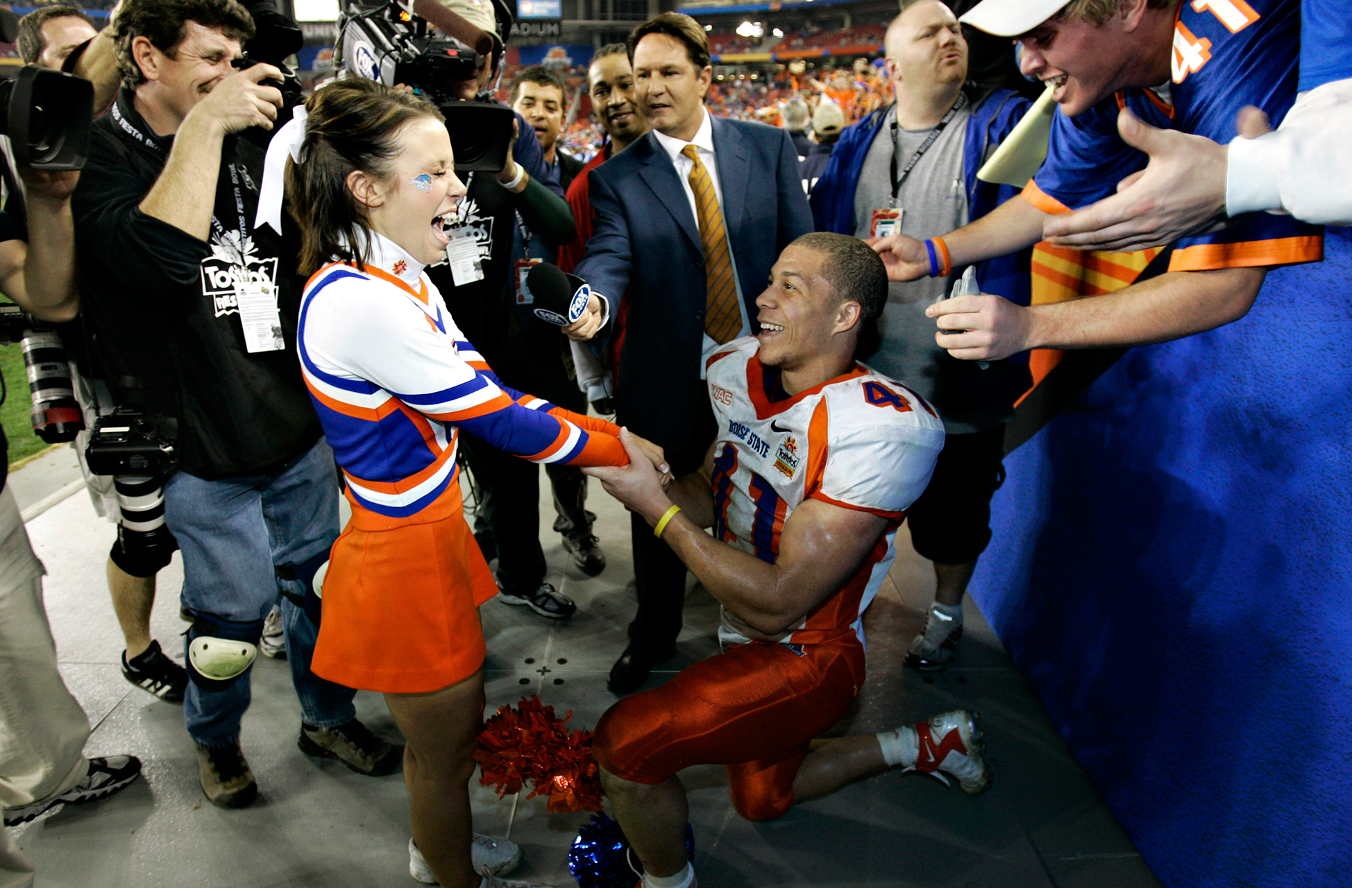 Boise State tailback Ian Johnson became the star of the 2007 Fiesta Bowl, not only for his role in the Broncos' upset over Oklahoma but also for his adorable proposal to girlfriend and cheerleader Chrissy Popadics immediately after the game.