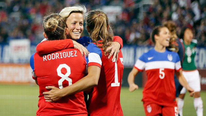 Amy Rodriguez hugged it out with teammates Tobin Heath, right, and Megan Rapinoe after scoring in the first minute against rival Mexico on Thursday in a pre-World Cup qualifying friendly in Rochester, New York.