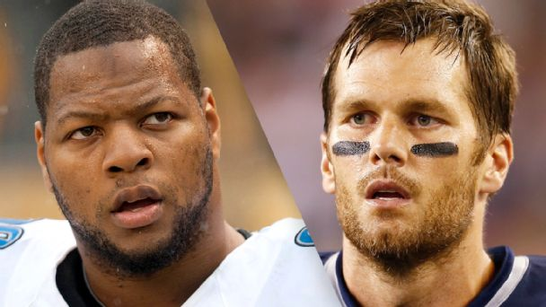 Ndamukong Suh and Tom Brady
