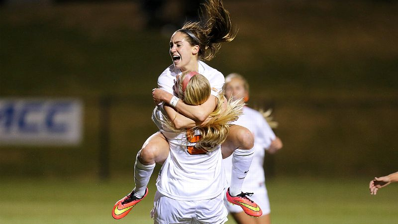 Morgan Brian (facing camera) leaps into the arms of Virginia teammate Makenzy Doniak after one of seven Virginia goals against Kentucky. Brian and Doniak combined for five goals and four assists.