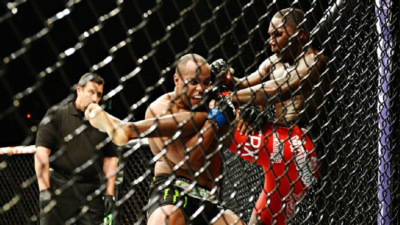Daniel Cormier wins light heavyweight title by submission, calls out Jon Jones