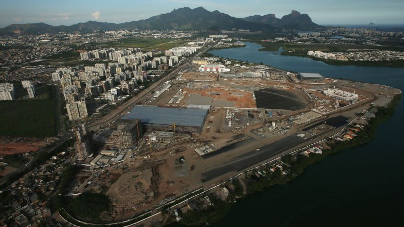 The cutbacks are not expected to affect construction of Olympic venues.