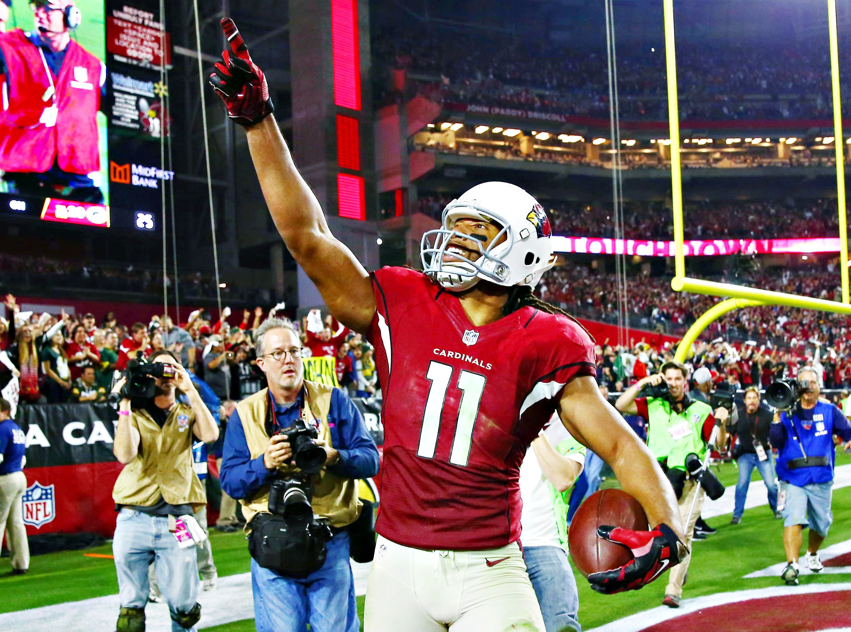Larry Fitzgerald celebrates s NFC Divisional Playoff