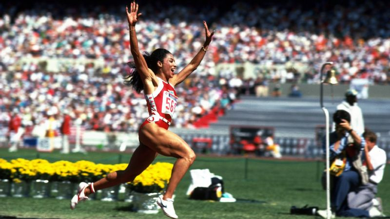 Florence Griffith Joyner celebrates her 100-meter win during the 1988 Olympic Games in Seoul.