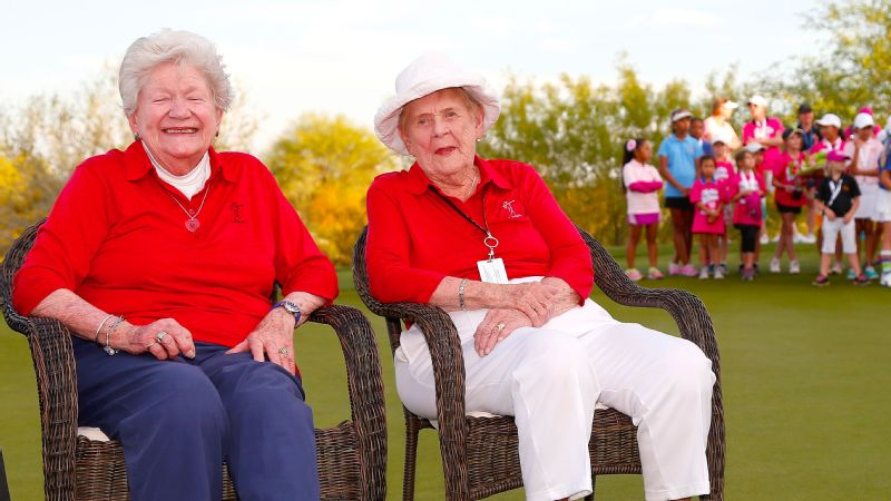 LPGA founders Marilynn Smith, left, and Shirley Spork sit on the 18th green as the Girls Golf Foundation looks on at Wildfire Golf Club in Phoenix in 2015.