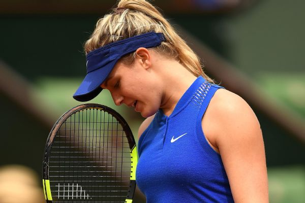 Eugenie Bouchard of Canada reacts during the Ladies Singles second round match against Timea Bacsinszky