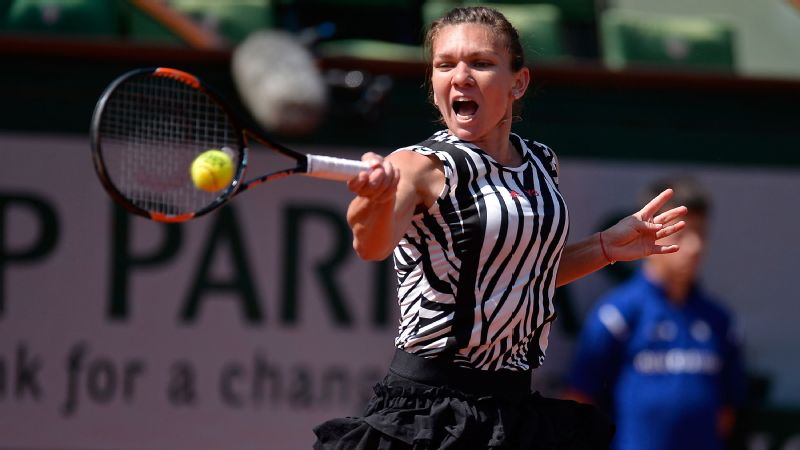 Simona Halep of Romania plays a forehand during her women's single second round match against Zarina Diyas
