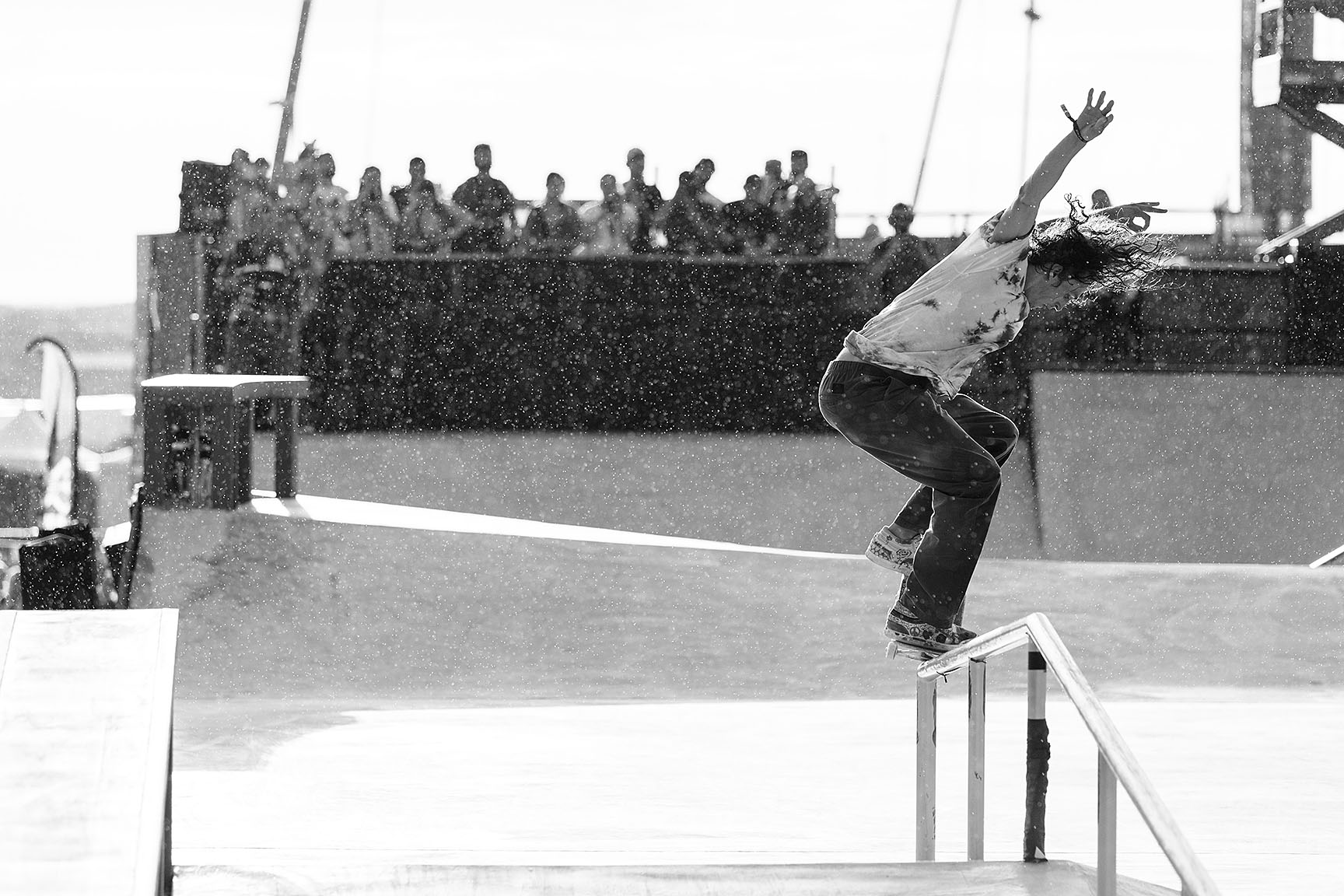 Evan Smith skates in the Men's Skateboard Street final between mini squalls during a commercial break. The storm that moved in before Men's Skateboard Street hit so quickly that no one got out of it dry. The final, when it eventually went down, was contested by a field of skateboarders with wet shoes and wet clothes but not dampened spirits.