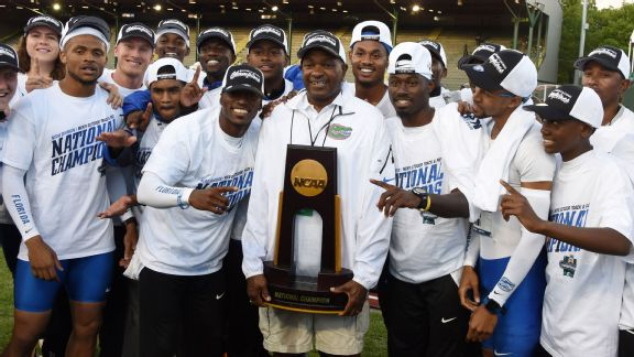 Florida coach Mike Holloway is surrounded by his athletes after winning the national title.