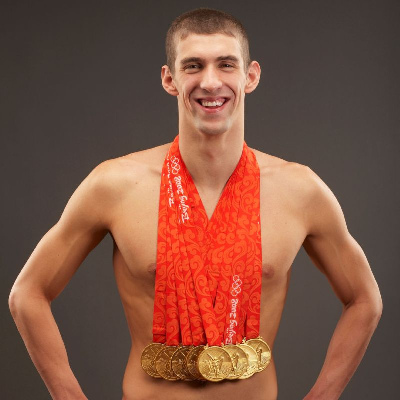 Image result for phelps with all his medals