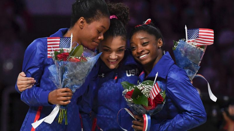 Gabby Douglas, left, Laurie Hernandez and Simone Biles were named to the U.S. Olympic women's gymnastics team on Sunday night.