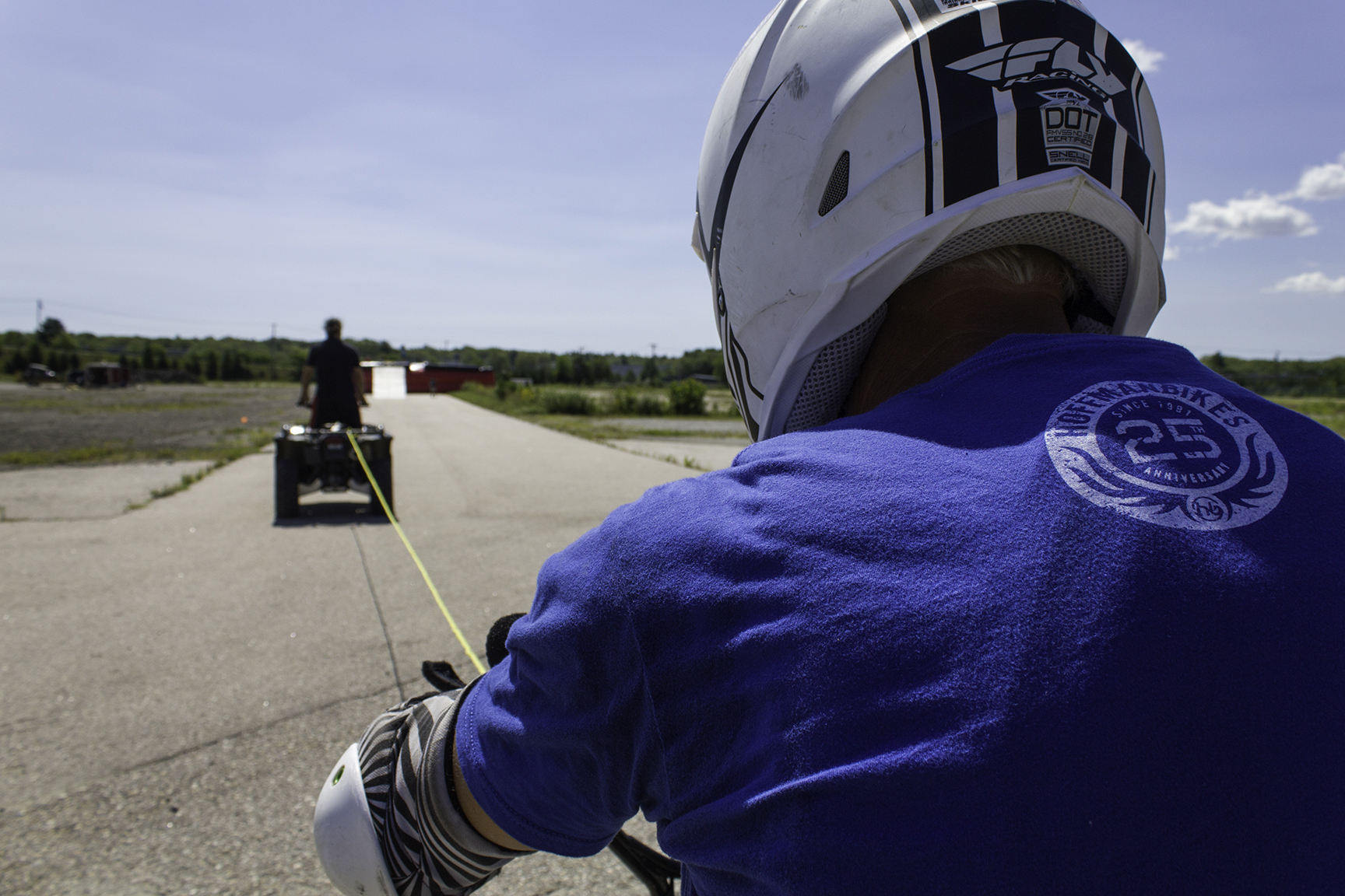 To achieve the speed Robinson needs to clear the distance, he is being towed in by an ATV four-wheeler.