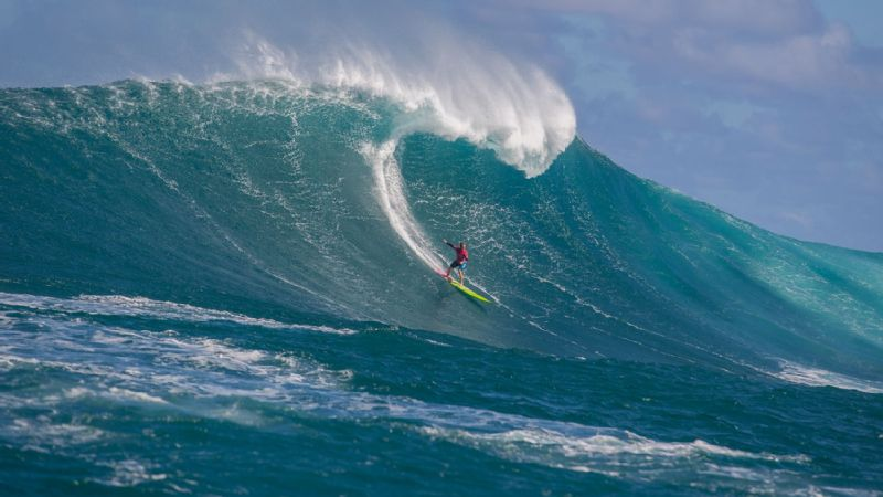 Paige Alms surfs Jaws, Maui's famed big-wave break, during Round 1 of the Pe'ahi Women's Challenge.