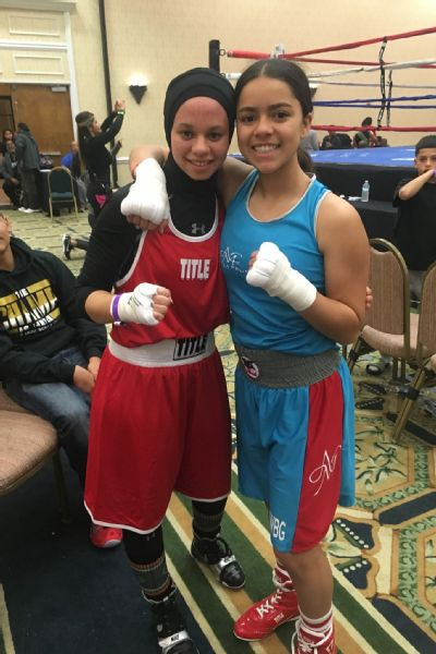 When Zafar was disqualified for wearing a hijab at the Sugar Bert Tournament, her opponent Aliyah Charbonier, 15, was declared the winner. However, Charbonier decided to share her belt with Zafar.