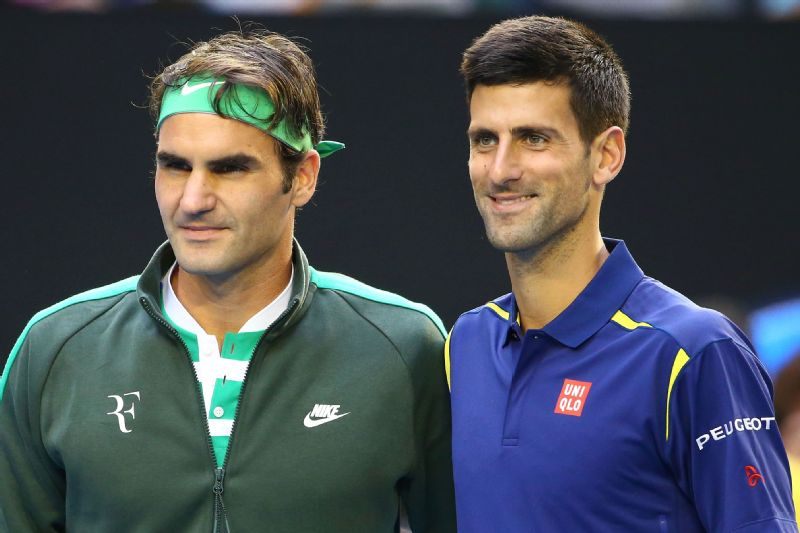 Novak Djokovic and Roger Federer pose together at the net ahead of their semi final match during the 2016 Australian Open at Melbourne Park on January 28, 2016.