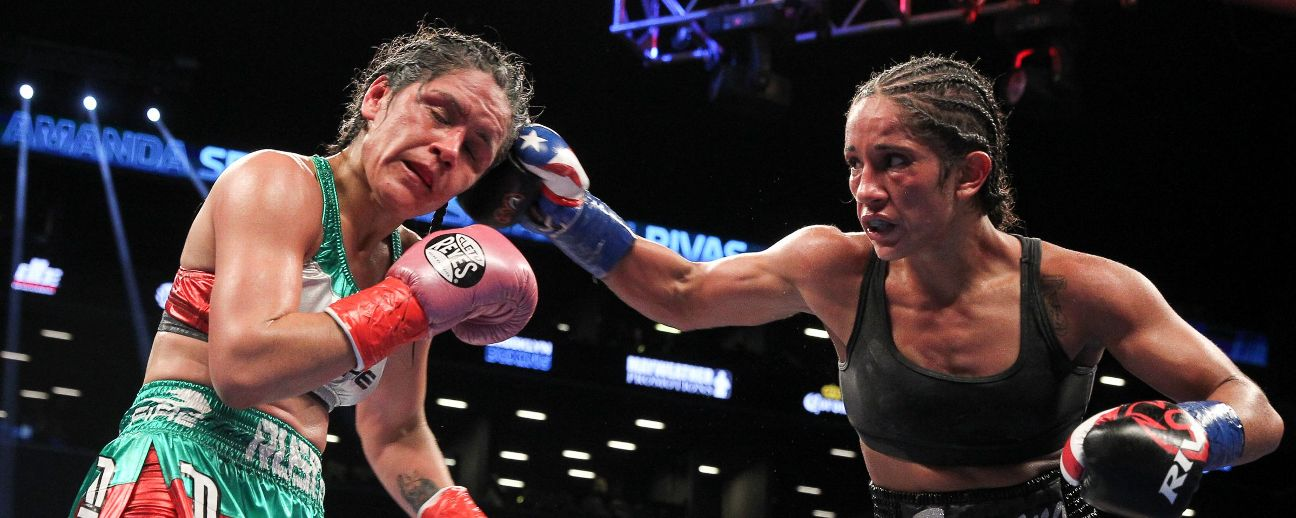 <a class='titles_link' href='view_news.php?link=http://espn.go.com/boxing/boxing/story/_/id/18476836/amanda-serrano-defeats-yazmin-rivas-first-english-language-women-title-bout-us-national-television-2007&title=Serrano keeps belt in rare televised women's bout</a&img=http://a.espncdn.com/photo/2017/0114/r171144_1296x518_5-2.jpg'>Serrano keeps belt in rare televised women's bout</a</a>