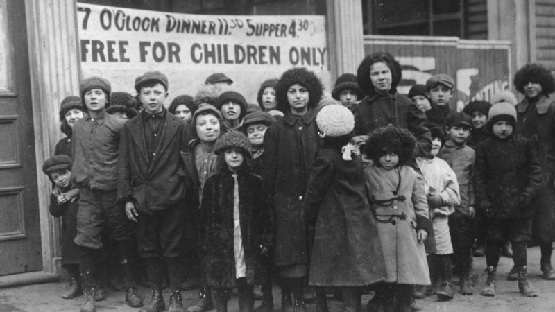 Children of striking workers in Lawrence, Massachusetts, wait for a free meal during the Lawrence Textile Strike (a.k.a. The Bread and Roses Strike) in 1912.
