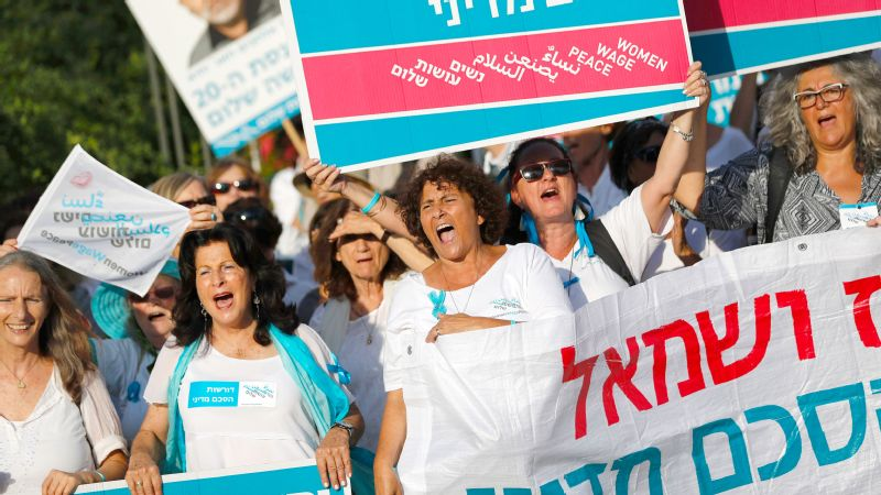 Several hundreds of Israeli and Arab-Israeli activists from Women Wage Peace, holding portraits of Israeli parliament members, take part in a march and rally outside the Israeli parliament in Jerusalem, on October 31, 2016.