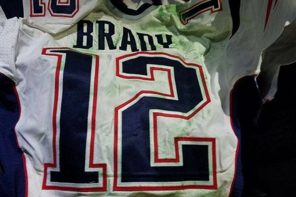 Tom Brady's game jersey from last year's Super Bowl was stolen from the postgame locker room by a member of the international media.