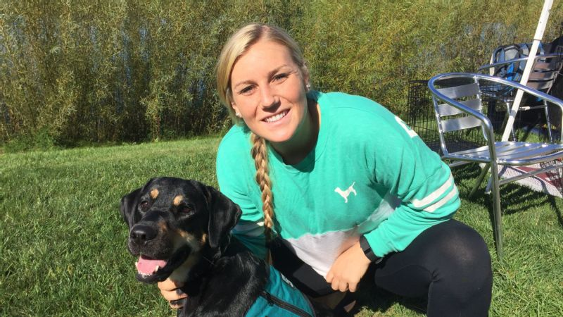 Wisconsin hockey player Annie Pankowski with one of the service dogs she helps train.